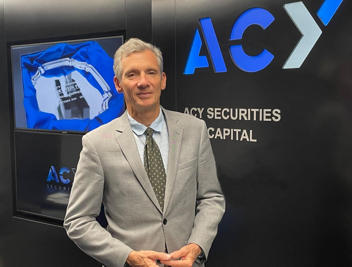 """ACY Securities appoints """"World's most accurate currency forecaster"""" and former BNP Paribas and Macquarie Bank superstar Clifford Bennett as their new Chief Economist"""